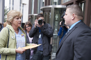 Donna Hoge, a Nursing Assistant at UPMC Sherwood Oaks, attempts to deliver a letter to UPMC CEO Jeffrey Romoff